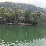 Looking across Lake Pokhara towards Fish Tail Lodge and its pontoon