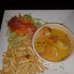 Shrimps with salad and fries