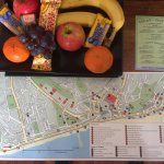 Fruit and snacks left for us on the dress (some eaten from the night before) and map.