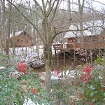 Ivy Cottage and Creek Crest cabins in winter at Welcome Valley Village
