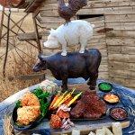 24oz. Prime Porterhouse, Roasted Pork Shoulder, Crispy Buttermilk Chicken Thighs.
