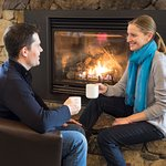 Enjoy a meal by the cozy fire