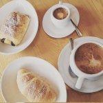 Apricot croissant, chocolate croissant, an espresso and a macchiato.
