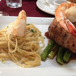 Fresh caught tuna steak with jumbo shrimp, pasta, and asparagus. Yum!