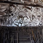 forged articles on display on the walls and ceiling