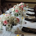 This is the table before the guests arrived. (We brought the flower arrangements.)