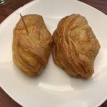 Chaves Pastries, one with veal, one with chocolate