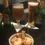 At the bar enjoying a Michelada nacional and local beer.