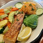Try the Grilled Salmon! Fresh salmon grilled with lemon and butter. Served with assorted seasona