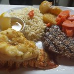 6oz Sirloin Steak & Lobster Tail, rice, roasted potatoes and carrots.