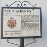 Tablet about history of the city hall.