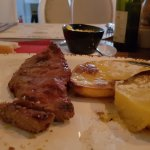 Ribeye steak, my favorite one.. with AMAZING potatos. Must try.