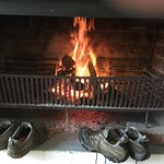 Shoes drying by the fire in our verandah room