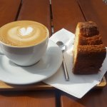 Cappuccino and cake at Yuka Espresso Bar in Brussels