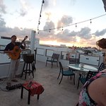 Fantastic guitarist at sunset for Happy Hour