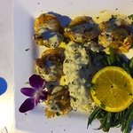 Crab Stuffed Shrimp - notice the live orchid!