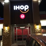 Some of the inside seating, some of the food served and the 24 hour iHop sign at nighttime