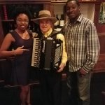 My husband and I with accordion player