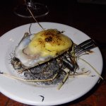 Lemon Hay Oyster appetizer -- the hay at the bottom comes lit up/burning, oyster is in shell