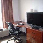 Great TV picture, only place to sit in 402, armoire is spacious for clothing. Ironing board and