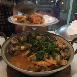 The cataplana is a rounded cooking pot
