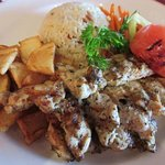 Chargrilled Chicken with potatoes, rice and sauteed vegetables.