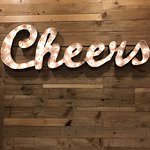 """This """"Cheers"""" sign was hanging on the wall"""