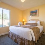 Queen Bed in One Room of Two Bedroom Condo Unit at the Indian Palms Vacation Club