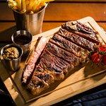 Signature Dish - Char grilled strip loin - 400 gram Australian roasted bone in strip loin, beef