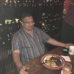 My brother, Prakash, feeling contended with his Liet Mignon with truffle sauce.