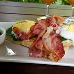 Eggs Bene with bacon and rukau