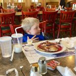 Six-year-old enjoys silver dollar pancakes with twinberry syrup