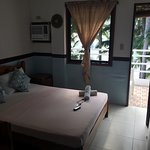 The cozy rooms of Casa Fiesta with balcony. Beahfront view where you can zip your mojitos as you