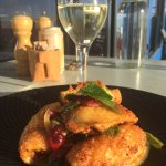 The salt and pepper squid with corn custard pomegranate vinegariette mint and coriander dressing