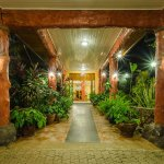 Our main entrance by night. The plants greet you to a fresh welcome and give a serene sensation.