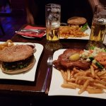 Left: Route 66 beef burger with curly fries. Right: Pork schnitzel with fries