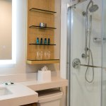 Stylish Glass Showers with Rain Shower Heads and lighted mirrors