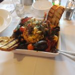 Fish Soup: Lobster tails, clams, prawns & cod in a tomato, white wine & parsley sauce