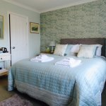 Our tranquil double ensuite room has a kingsize bed