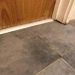 Dirty & uneven floor tiles in bathroom