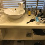 Tiny mount of storage for 2 on vanity