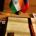 A welcome note, our National flag(Indian) and the RUssian flag on the tableand a souvenier