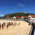 School children playing volley ball