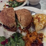 Veggie burger on 7 grain with carrot soufflé, bistro salad, and twice baked potato.
