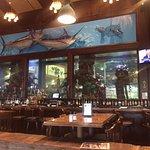 Beautiful huge saltwater aquarium behind the bar