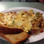Baked potato omelette with potatoes, cheese, sour cream and bacon.