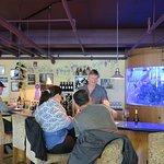 Main wine bar and aquarium; Scott is the winemaker pouring