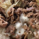 Cheesesteak with grilled onions, bacon cheese fries, ultimate pork with melted provolone and spi