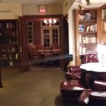 lounge library area leading to dining hall (night time)