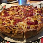 Excellent, flavorful pizza with a fun, sports bar atmosphere. Small but good wine list.  Origina
